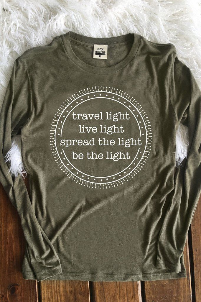 Travel Light. Live Light. Spread the Light. Be the Light - Long Sleeve Color: Heather Olive Made out of 50% Polyester, 50% Cotton Sizing Notes .... Small - 0/2 Medium - 4/6 Large - 8/10 XL - 12