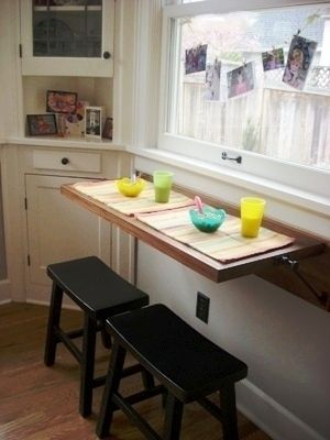 Love this solution for a tiny kitchen. Doubles as counter space and breakfast bar.: