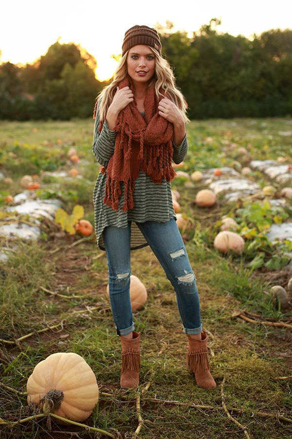 If you're looking for the perfect pumpkin picking outfit, Parker is your girl!  Add a cute scarf and a beanie for a layered look that's everything we love about fall!  {The Parker Tunic Sweater by @merittclothinglabel $39, Sound Fringe Bootie by @sbiccafootwear $89, Lover's Lane Skinny $42, Pumpkin Patch Tasseled Blanket Scarf $26, Beanie Beautiful $14} #ShopImpressions #MerittBabe #SbiccaFootwear #FallFashion