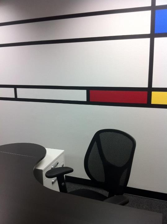 Custom Mondrian inspired wall murals create a productive business environment, that is far from dull.