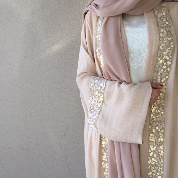 A chic light open abaya by Qabeela. Perfect for summer evenings out. The sequin border adds a touch of girly fun. Shop now at Haute-Elan.com #Ramadan #Eid #Abaya #HauteElan #Qabeela #Pink #Women #Fashion #Hijab #Modest