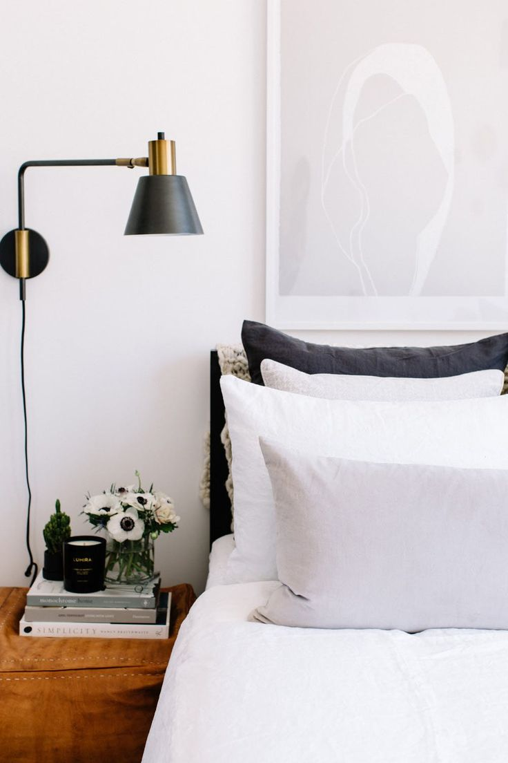 The bed linens are from Cultiver Goods. The wall sconce is from West Elm.
