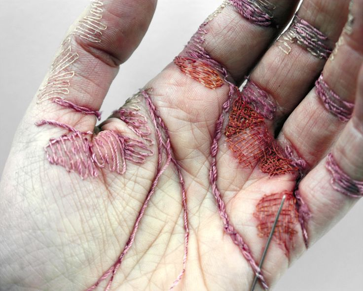 eliza bennett embroiders a self-inflicted sculpture into her palm skin