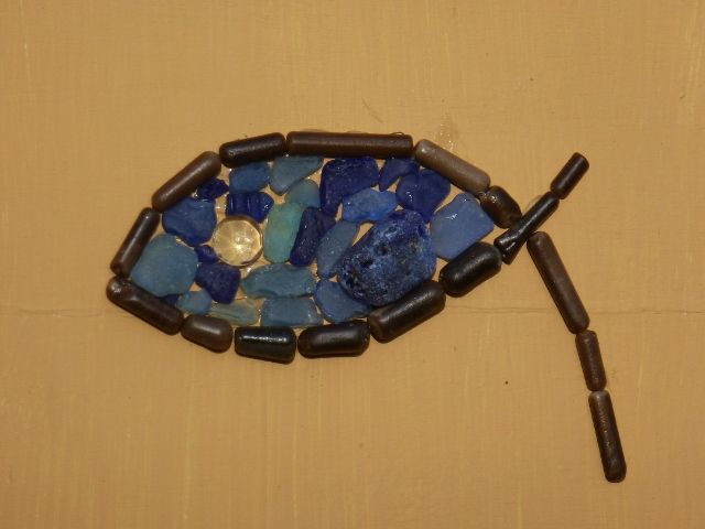 fish with blue seaglass and oiled     belemnite surround,crystal eye.