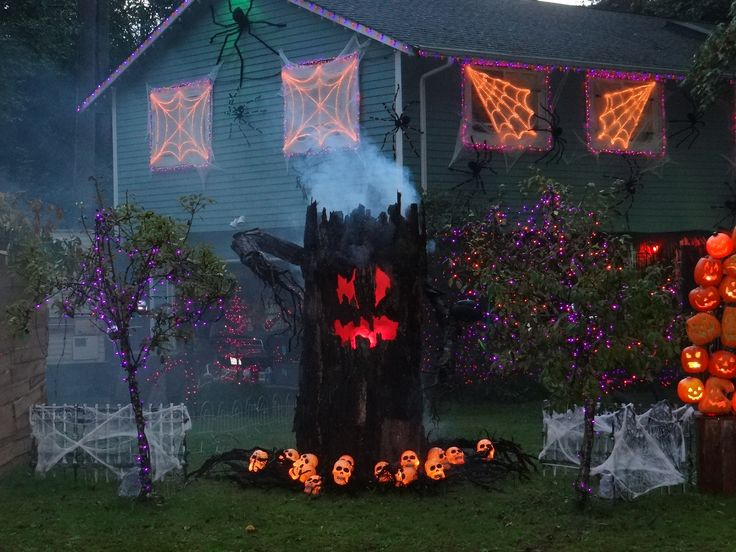 use rope lights to create a giant scary spider web halloween decorating with lights - Halloween Pathway Lights
