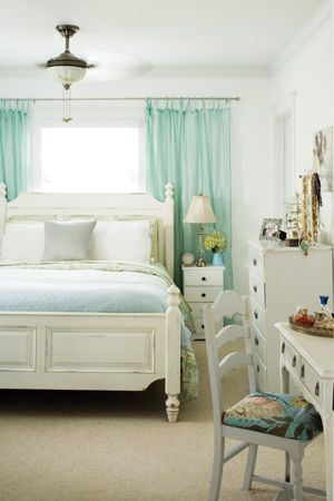 Curtains Behind Bed Ideas | Placing curtains behind the bed added texture and warmth to this white ...