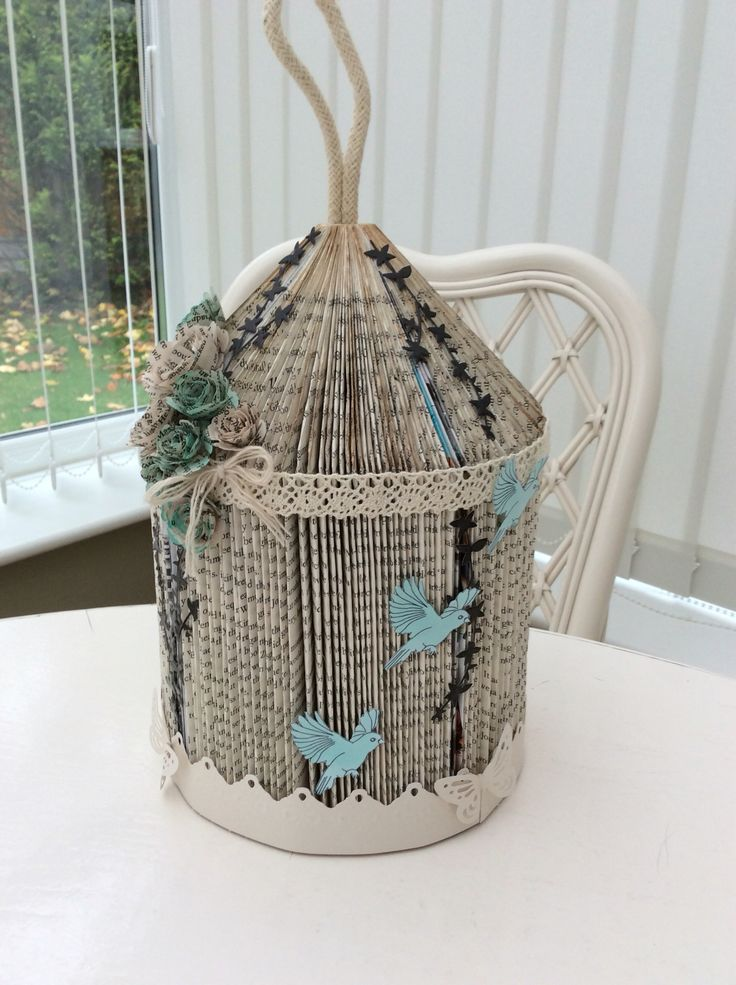 Book folding birdcage.                                                                                                                                                                                 More