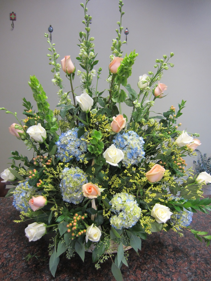 Peach, blue and white sympathy basket by Concord Flower Shop