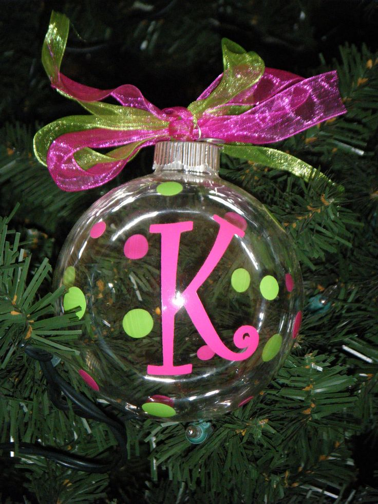 Personalized Christmas Ornaments. $8.00, via Etsy OR make them yourself!  You can get the clear bulbs at any store that sells craft supplies.