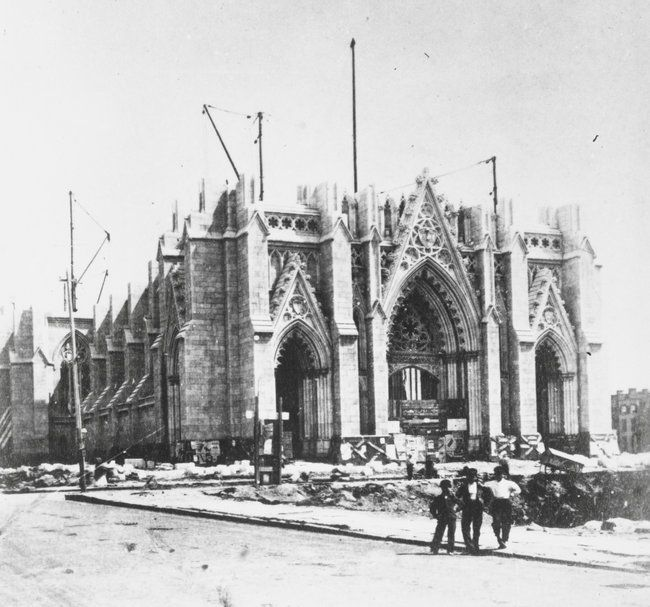 """The cornerstone of ST. PATRICK's CATHEDRAL was laid in 1858, 5-years after ARCHBISHOP JOHN HUGHES proposed his plan.   Ridiculed as """"Hughes' Folly,"""" as the """"near-wilderness"""" site was considered too far outside the city, the Archbishop persisted in his daring vision of building the most beautiful Gothic Cathedral in the New World.  Neither the bloodshed of the Civil War nor the resultant lack of manpower or funds derailed his' dream.  (PHOTO:  Construction of St. Patrick's Cathedral, 1868.)"""
