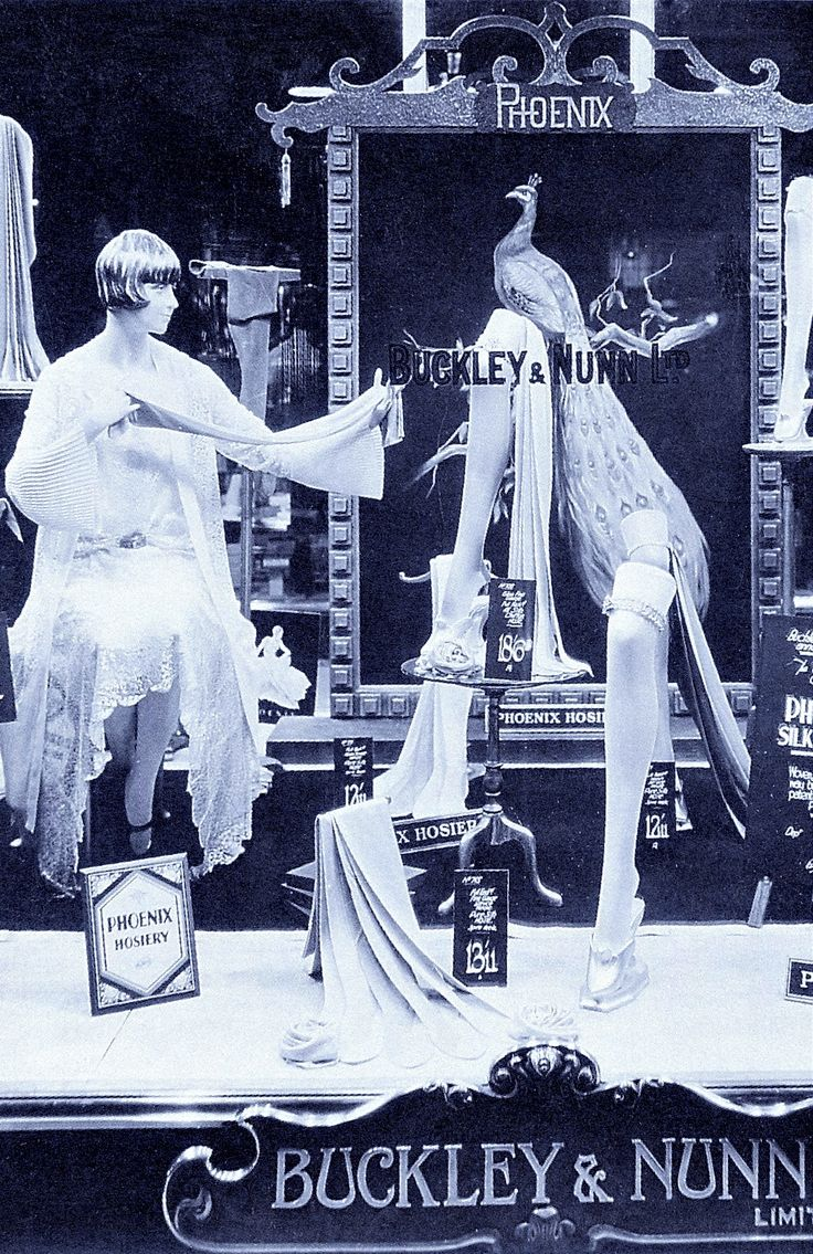 "1920's department store window display (detail) BUCKLEY & NUNN AUSTRALIA ""Short skirts not only allowed for daring window displays -they created fierce competition in the stocking market."" from Parade The Story of Fashion in Australia by Alexandra Joel (please follow minkshmink on pinterest) #twenties #flapper #twentiesdisplay #deco #decocover #windowdisplay #mannequin #stockings #hoisery"