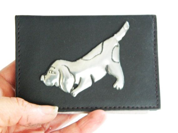 A leather cow hide credit card wallet with a pewter puppy motif that adds a touch of fun to this very useful wallet