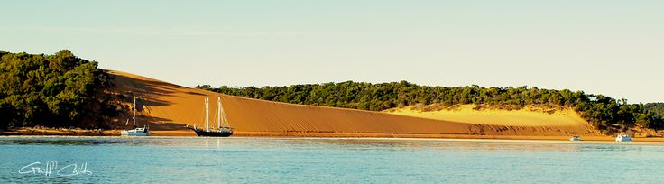 "Extraordinary Vista of the unique golden sands of the picturesque beach and sand hills of ""Yellow Patch"", Curtis Island,  Queensland, Australia."