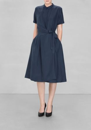 A-Line Silk Dress - Feminine and elegant, this silk dress features a buttoned upper and a skirt that ties together to create a beautiful drape-effect.