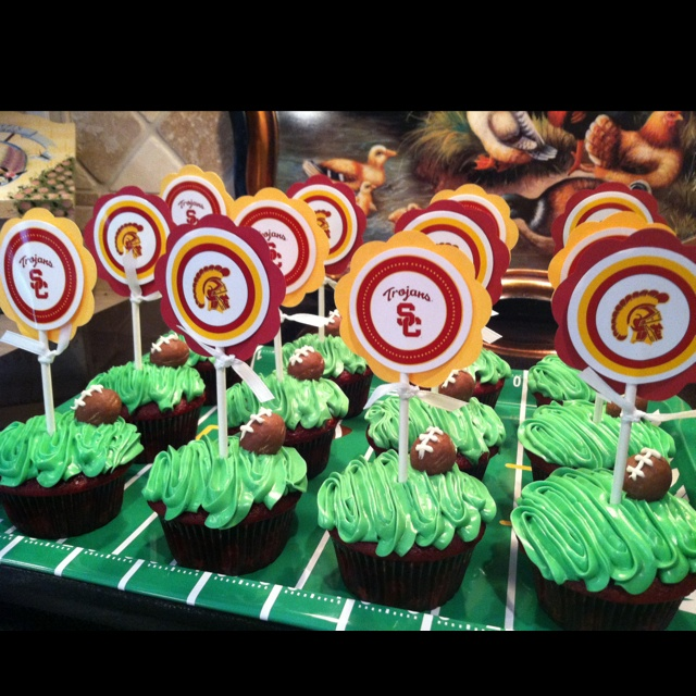 USC Trojans birthday football cupcakes. I used chocolate Easter eggs for footballs.