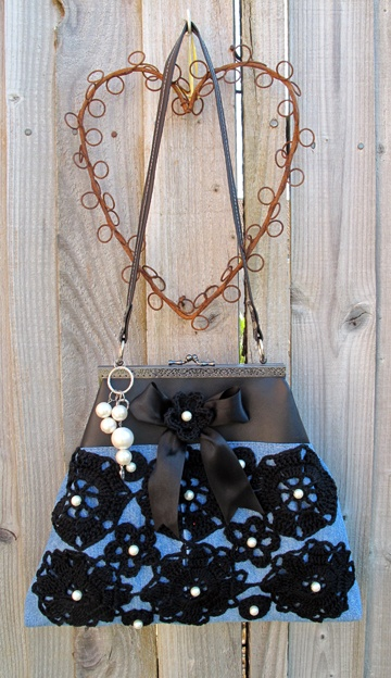Denim handbag with black crochet flowers and pearl beads