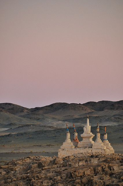 Bayangovi, Sunset In The Gobi  At sunset, around the Bayangovi Gobi Camels Ger Camp, the desert colours are beautiful. At the top of a hill, there are some remains of a monastery destroyed during the 1937 purges.