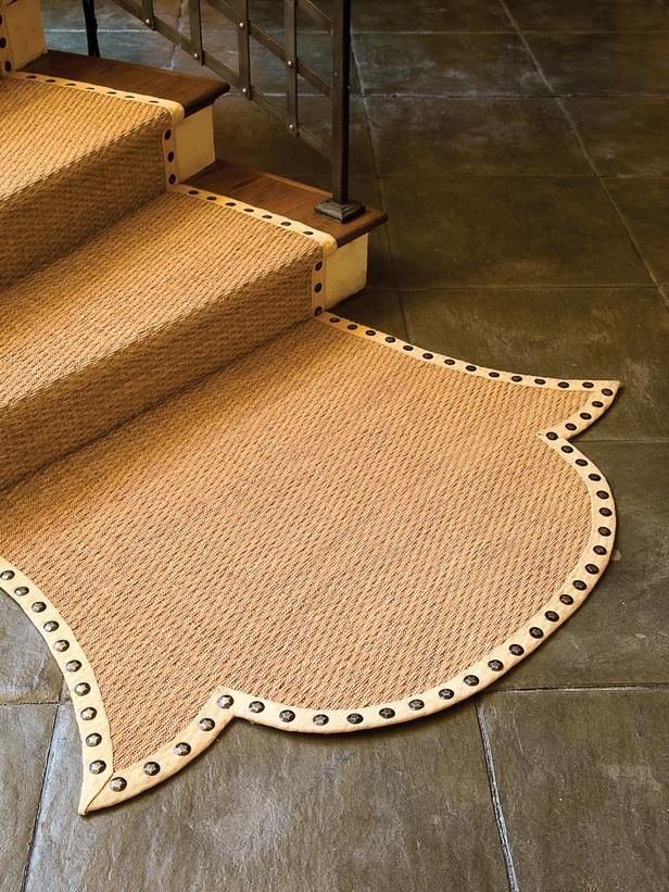 Seagrass Staircase Carpet Runner Ending in a Fish Tail Design on Concrete Floor - on HGTV