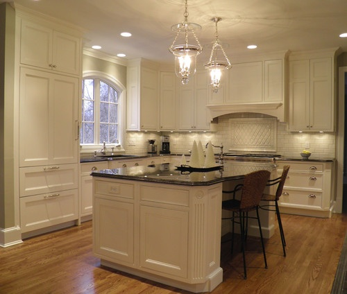 white kitchen island also antique brown granite countertop aldo classic white kitchen cabinets and beauteous chandeliers also light brown laminate floor 37 best pilasters images on pinterest   kitchen ideas flute and      rh   pinterest com