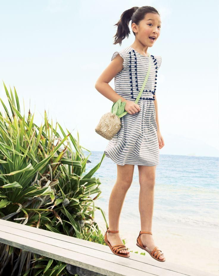 J.Crew stripe pom-pom dress and glitter pineapple bag. Love both of them!