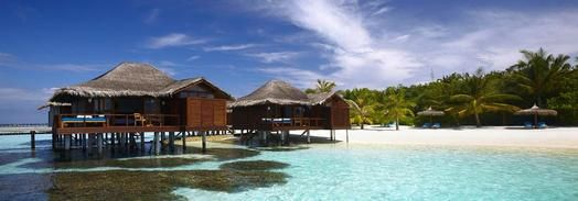 Sandy beach and overwater rooms
