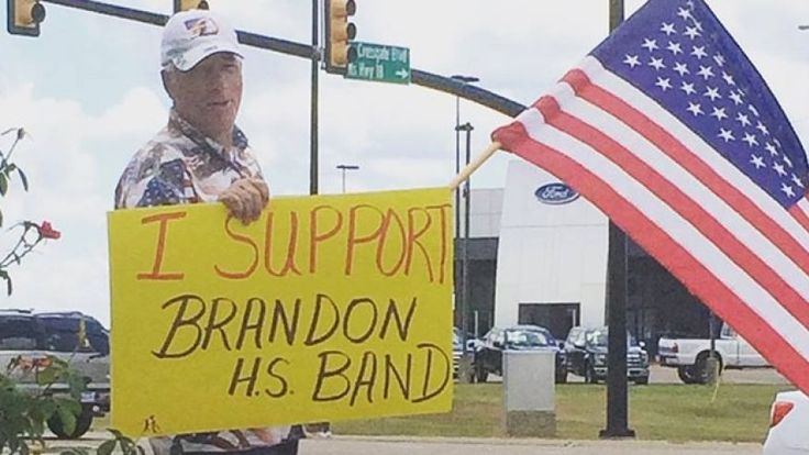 School band told to stop performing 'How Great Thou Art' A man shows his support for the Brandon High School band in Mississippi.
