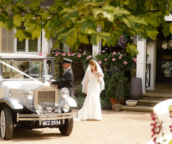 Arriving in style at Russets Country House wedding venue in Surrey | CHWV - wedding venue