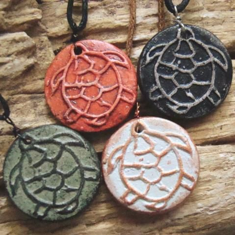 Live Love ArtHandmade Turtle Pendant - Custom Colours  Each lovely piece of jewelry is made from stoneware clay, kiln-fired, then painted with acrylics, and protected with a water based varnish.  Aradia Gallery