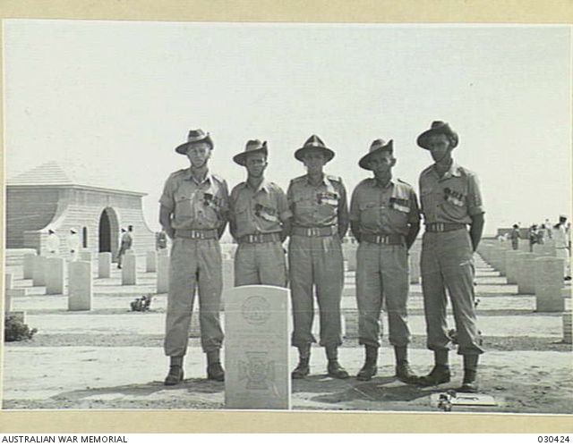 Tobruk, Libya. 25 April 1953. Group portrait of five Victoria Cross winners, members of the Australian and New Zealand Coronation Contingent, in the Tobruk War Cemetery, during their brief stay while on their way to England to attend the coronation of Her Majesty, Queen Elizabeth II. They are, left to right: Private (Pte) Frank John Partridge VC, Pte E. Kenna VC,215003 Sergeant J. D. Hinton VC, Pte R. Kelliher VC,; Sergeant R. R. Rattey VC, 030424 | Australian War Memorial