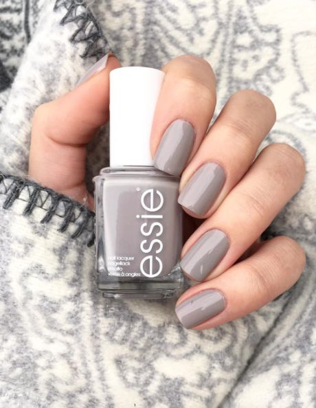 Want to star trouble? Don a punchy, fresh taupe essie mani with a whisper of pink and hit 'em with your best shot.