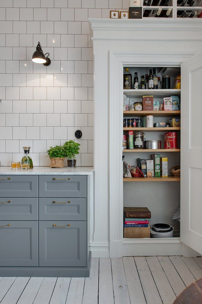 Tile, whitewashed floors, gray cabinetry