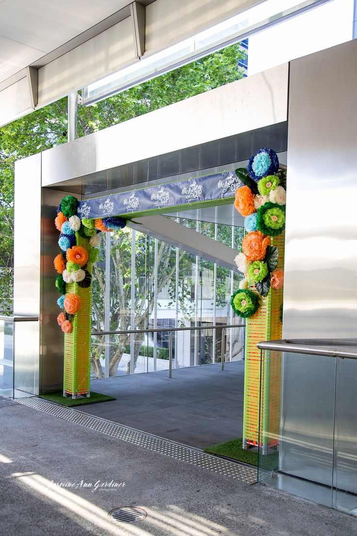 DY.o events (aka Duo)  Melbourne Cup Event entrance with paper flowers and coloured tape.