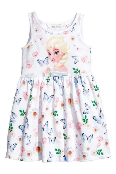 Rochie fără mâneci de jerseu cu imprimeu, cu cusătură în talie și cu fusta evazată.