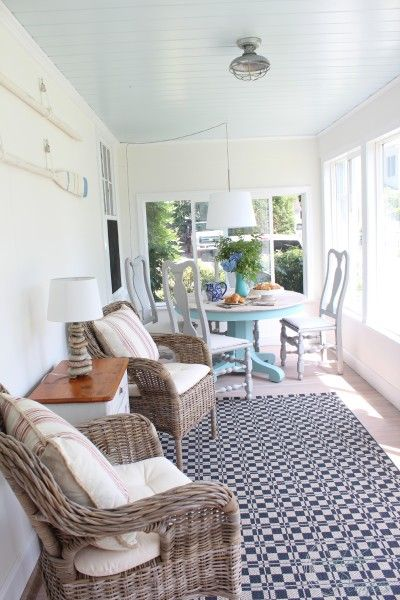 Coastal Sunroom Reveal with @benjamin_moore colors - Simply White, Pure White, Ocean Air and floor stain.  #sponsored