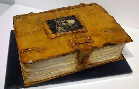 Leather bound Shakespeare book cake By Über Angel Cakes - Cake Wrecks. Hand painted and worn leather detail...just amazing...!