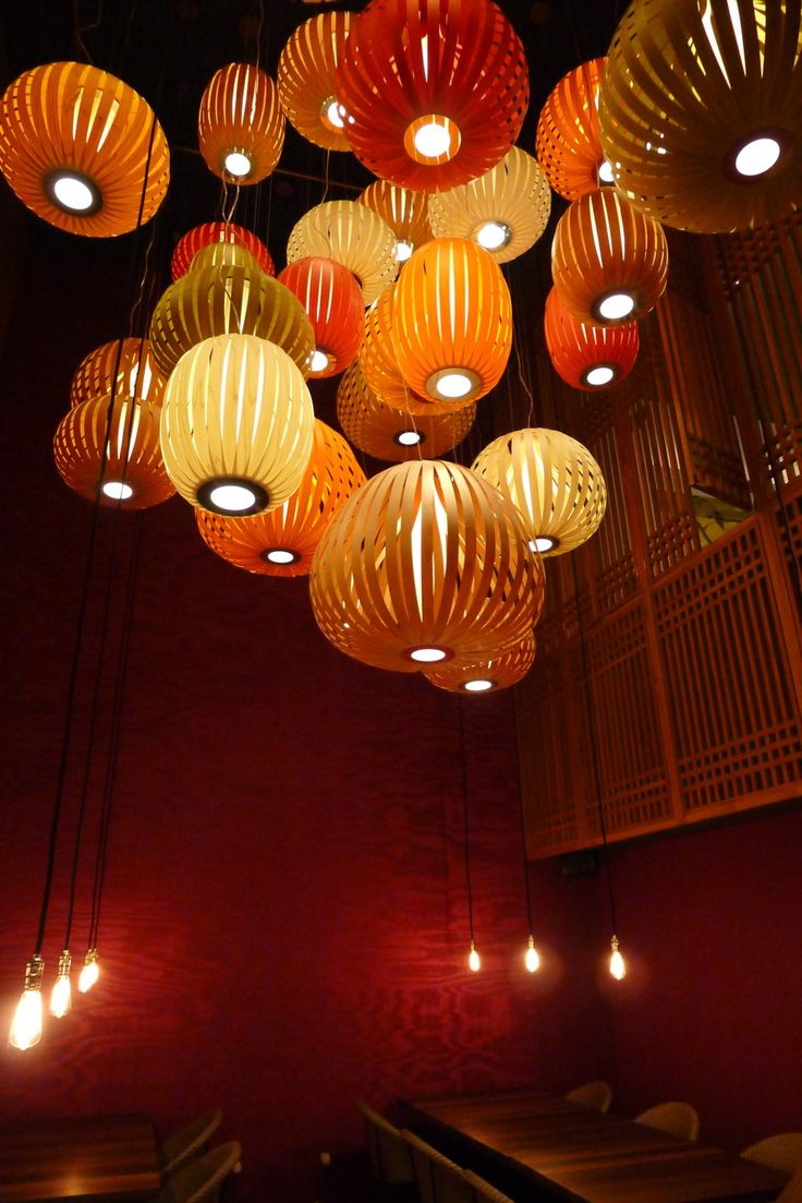 The entrance of the Soya Cosplay restaurant in Berlin, featuring LZF Poppy Pendant Lights.