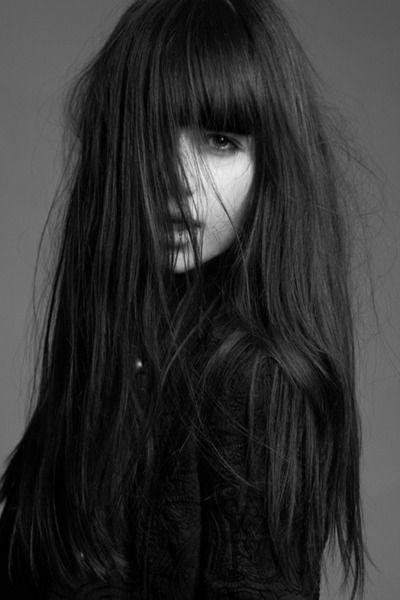 { Bangs and long hair. }