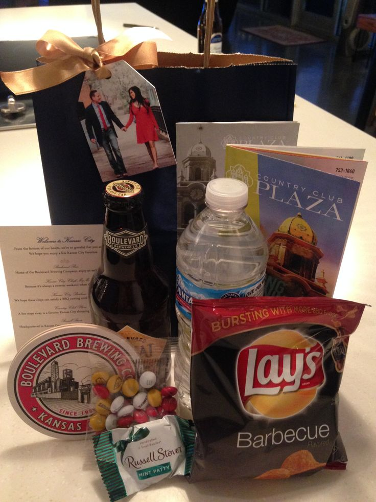 Final result - Our Kansas City themed guest welcome bags - Blvd. beer and coasters, BBQ flavored chips, KC Chiefs logo M&Ms, Russell Stover chocolate, water and Plaza pamphlets with welcome note #wedding #KC #guestbag
