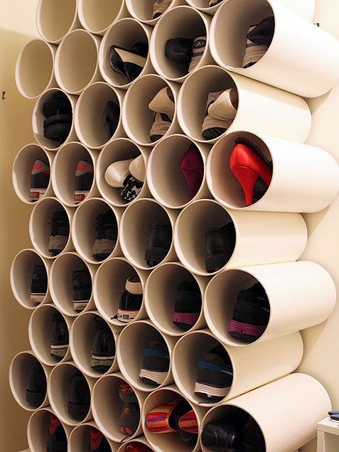 Stacked PVC Pipe ~ stacked and glued PVC pipe to create a cool honeycomb-like shoe rack. To store most flats and heels, choose pipe that is 150mm in diameter. Running shoes or men's shoes will need a larger diameter -- or just store one shoe per pipe. Ask your local hardware store cut the pipe slightly longer than your longest shoe. 8 MORE IDEAS TOO!!