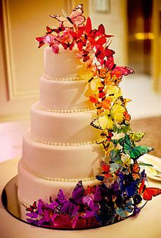 Rainbow Wedding Cakes -- a lush cascade of silk butterflies in rainbow hues ~ by Delicious Desserts