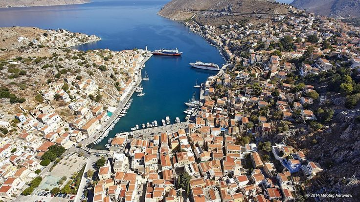 Symi in Dodecanese: Try not to fall in love with Symi...it's impossible! It's so picturesque that it looks like a painting and so colorful that it puts a smile on your face! Explore it and enjoy! #symi #greece #dodecanese #SouthAegean #summer #vacation #picturesque #greekislands #travel #aerialphotos #aerialvideos #TrustYourEyes #TRIPinVIEW