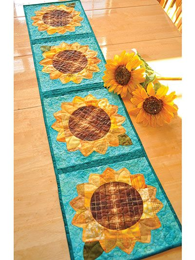 The patchwork design of this heartwarming pattern gives it a down-home, country feel that is perfect for displaying year-round. Use scraps or coordinating yardage and some simple applique, and you'll have a great table runner for your kitchen or a lo...