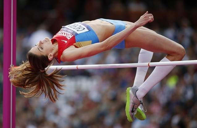 Russia's Anna Chicherova clears the bar in the women's high jump final during the athletics in the Olympic Stadium.
