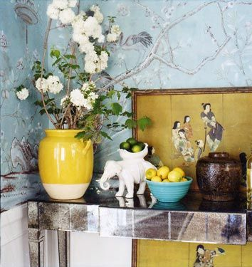 Note the Chinese print is apparently sitting on the floor, and held against the wall by the mirrored Parson's table. Wouldn't this whole vignette be great as a bar?  The elephant and the bowl are already taking care of the lemons and limes.  By Windsor Smith.