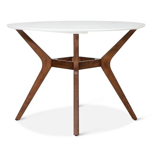 """Circle up for meals and games with the Westbrook Mid Century 42"""" Round Dining Table from Threshold. This two-tone dining table brings together a dark angled wood base with a clean white top that looks simply chic."""