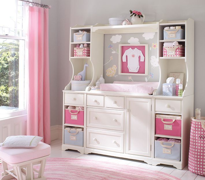 I love the storage options! And the onesie in the frame. It would be perfect to put baby's coming home outfit in. Home by Heidi: {Baby Girl Nursery Ideas!}