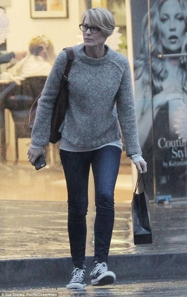 Robin Wright makes dash for it in LA downpour after visiting salon