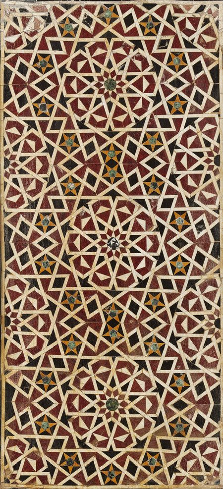 This Egyptian wall treatment is made up of red, white, yellow, green, and black marble to form a mosaic of geometric patterns based on five and ten point stars typically found in mosques.