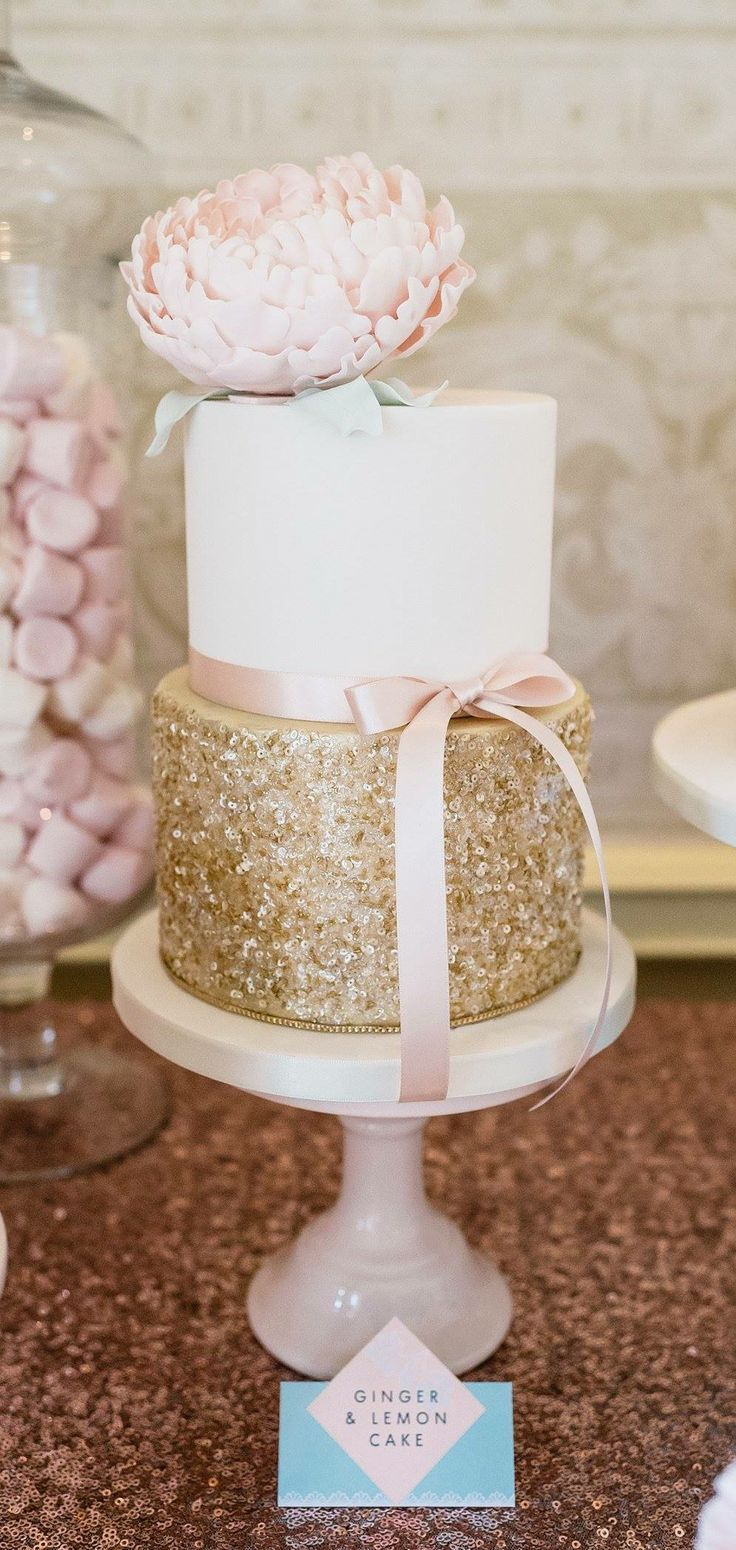 Gold glitter on a cake is just one of the many ways to add the glitz and glamour you always wanted to your wedding day.