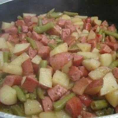Large can of green beans, 8 cubed russet potatoes, 2 packages of kielbasa (or regular sausage), 1 diced onion, 4 chicken bullion cubes. Put all together in crock pot and cook on high 4-6 hours